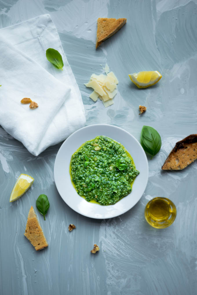 Pesto served on a dish with ingredients