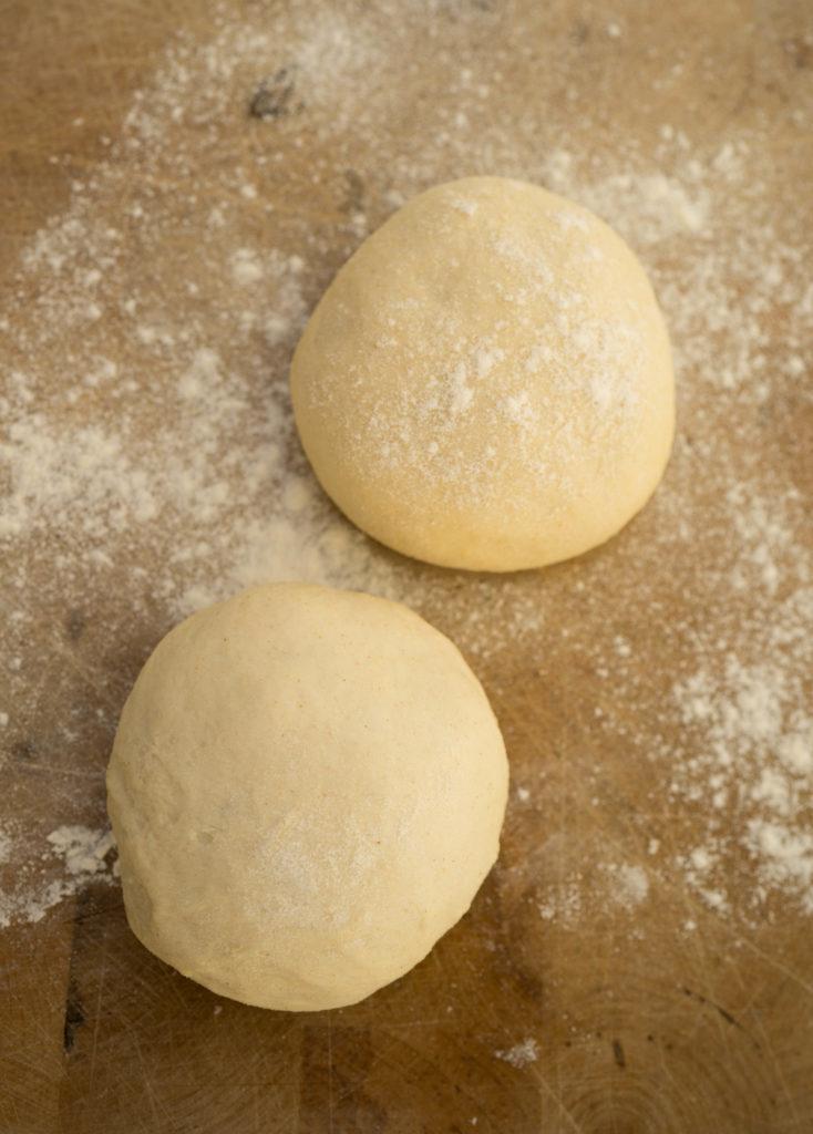 Pizza dough on a cutting board