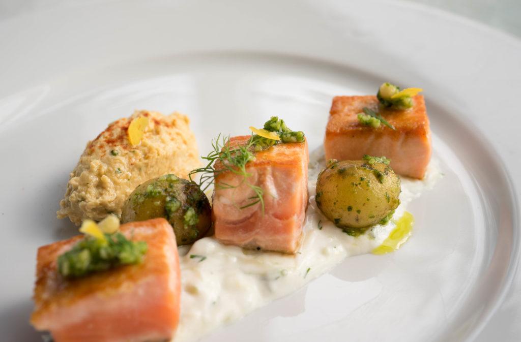 Salmon with humus tzatziki and pesto potatoes