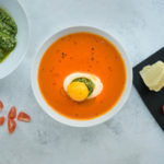 Tomato soup in a bowl with egg