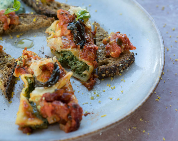 Vegetarian cannelloni served on a dish with home/made bread and good olive oil