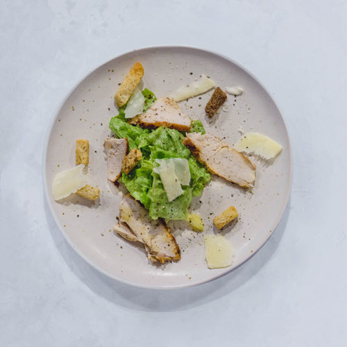 Caesar salad served on a dish