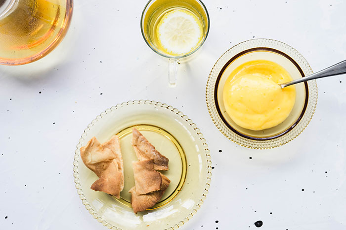 Lemon curd with tea and crackers