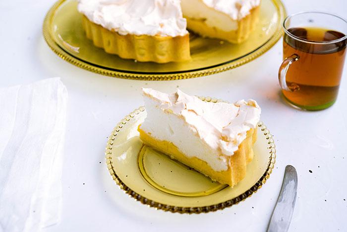 Piece of lemon pie on yellow gals dish