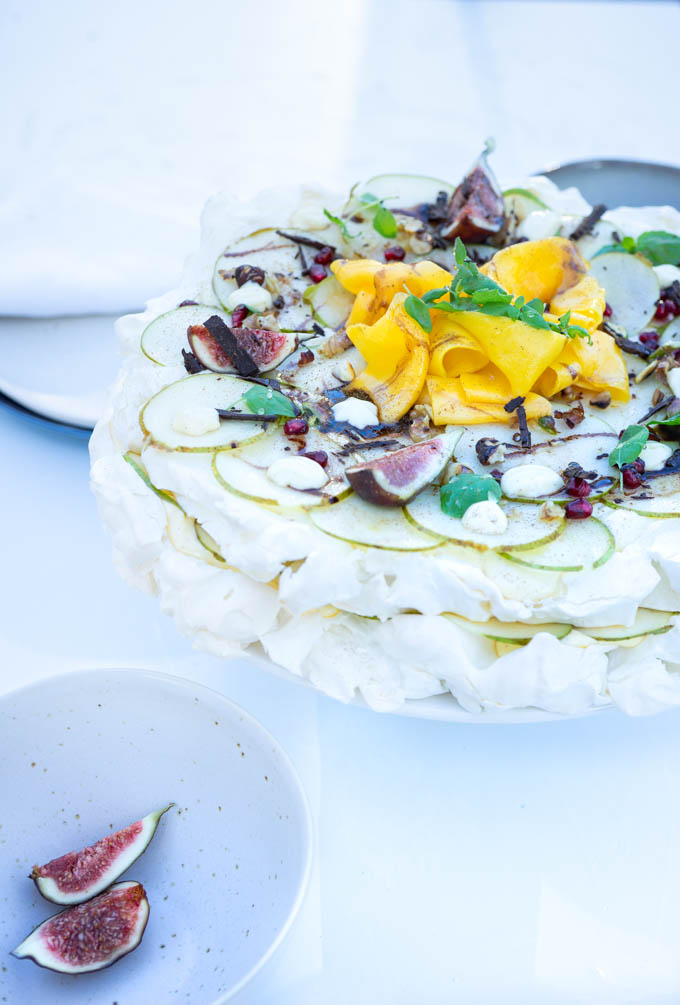 Pavlova with mango, figs and pear