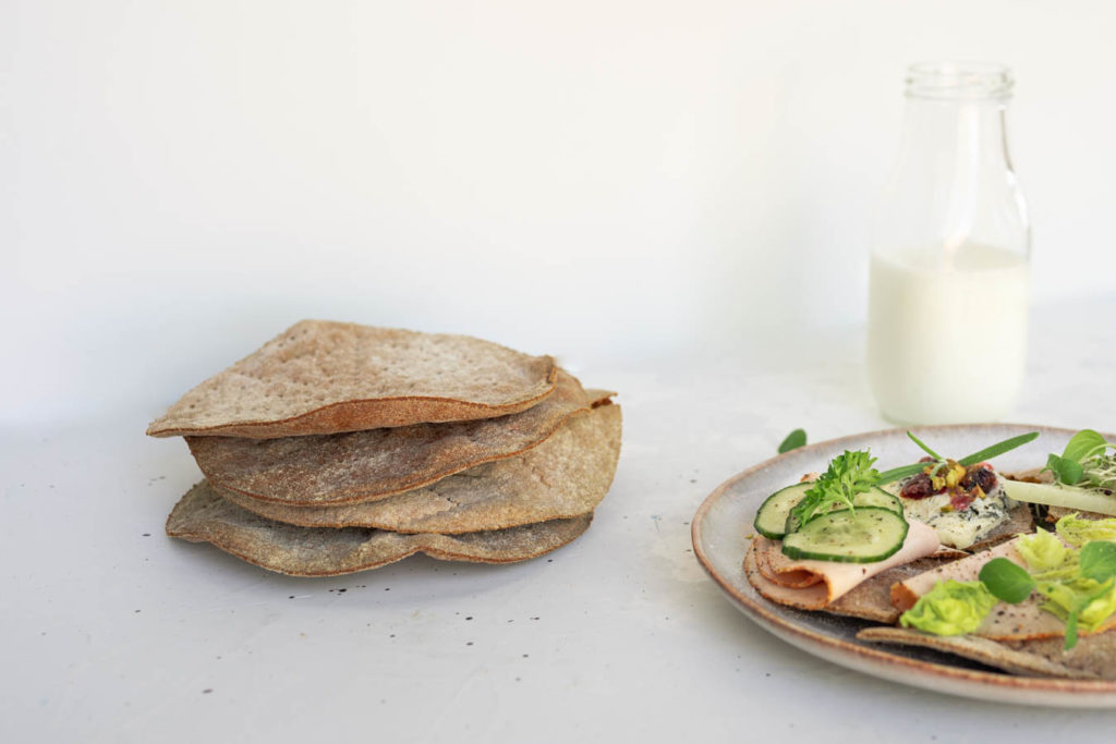 Rye Crispbreads stacked with a bottle of milk