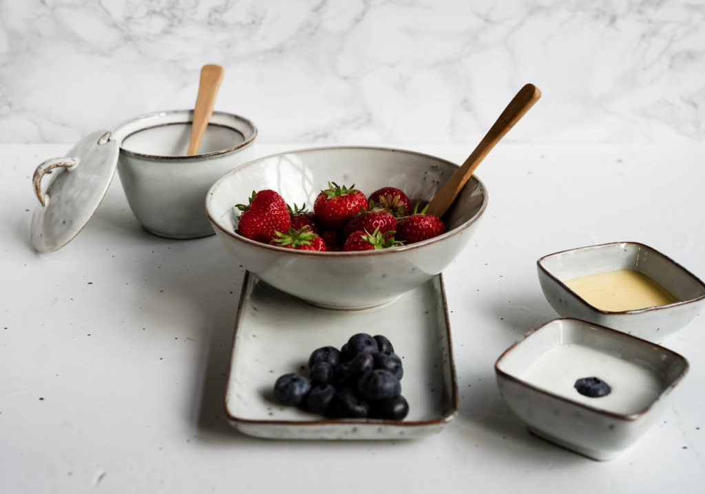 Blueberries and strawberries with vanilla sauce