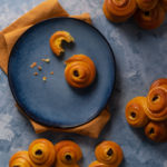 Norwegian saffron buns on a blue plate with a yellow napkin